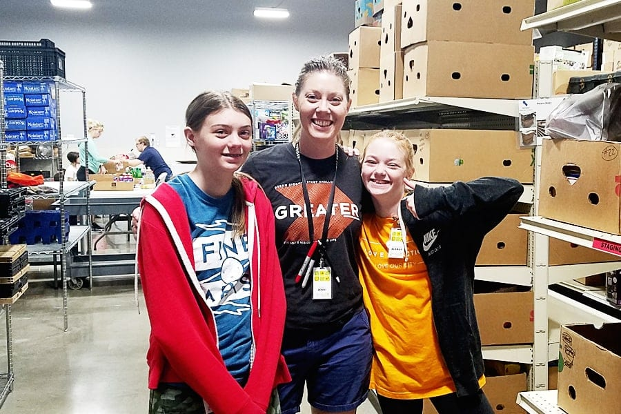 Jessi and her girls volunteer every Tuesday