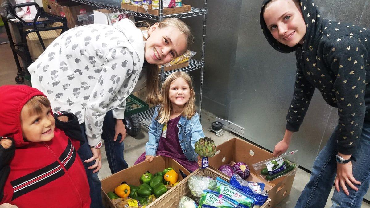 Summer kids volunteer at Amazing Grace Food Pantry