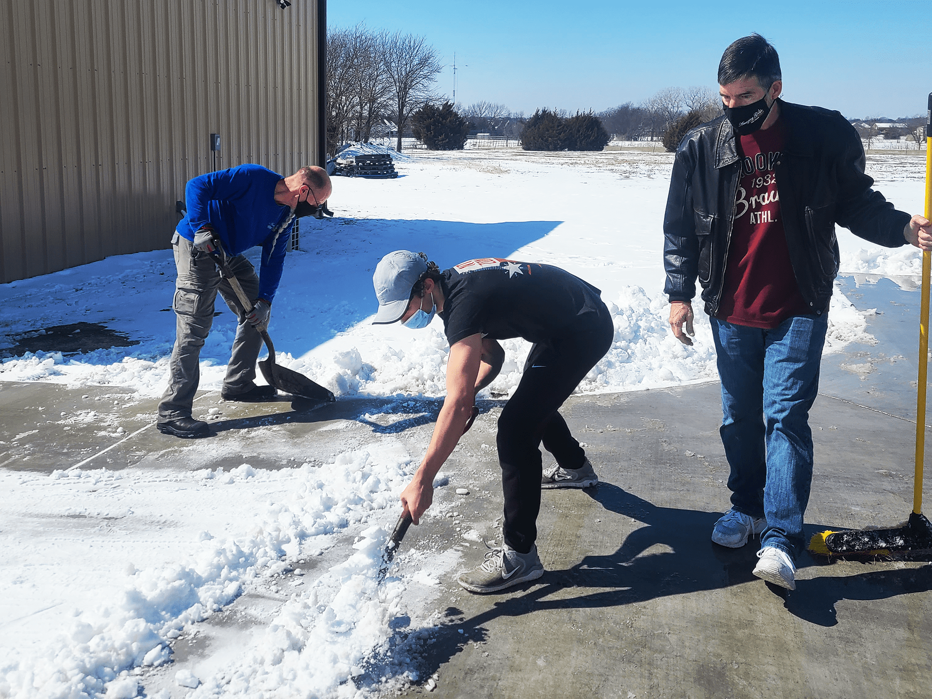 Volunteers cleaning snow at Amazing Grace Food Pantry